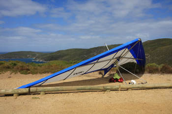 Hang Glider preparing to launch from Shelley Beach platforms
